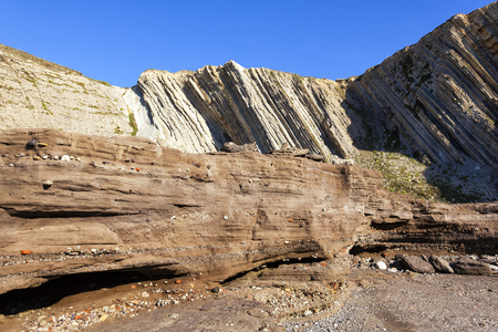 wastes: Tunelboca cemented beach in Biskay, Spain. Sampleof the anthropocene era age, with a 7 m layer of industrial sediment deposits in the coast, formed by the wastes of the former Altos Hornos de Vizcaya steel mill