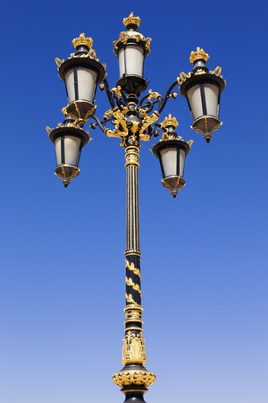 ornated: Gold colored classic style streetlight Stock Photo