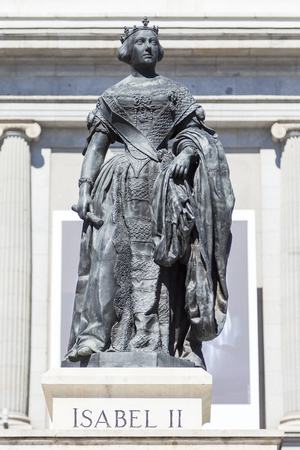 queen isabella: Statue of Isabel II, queen of Spain, placed on Plaza de Isabel II, besides the Royal Theatre in Madrid, Spain Stock Photo