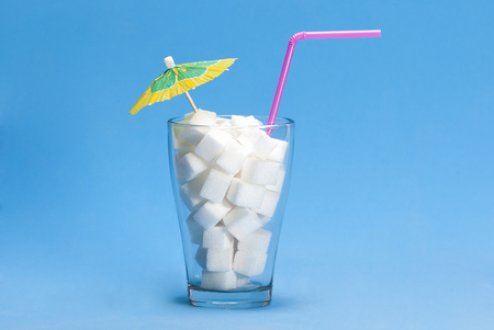 Glass with sugar cubes as a concept of drink with too much sugar Zdjęcie Seryjne