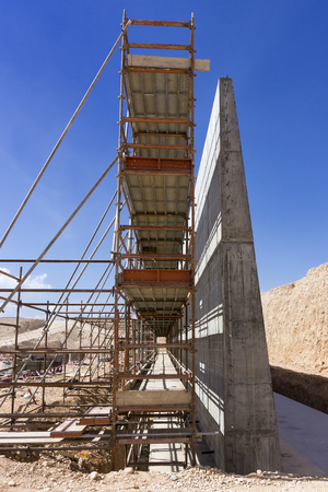 Reinforced concrete wall and scaffolding Stock Photo