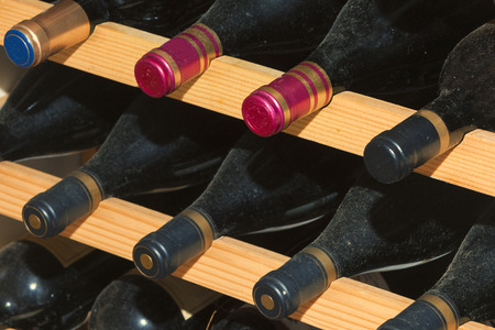 Wine cellar, with bottles on wooden shelves