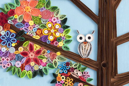 Owl on a branch of a quilling art tree