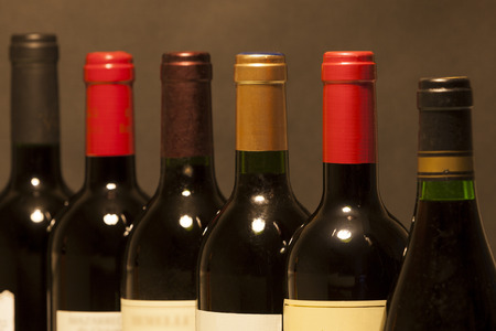 Selective focus on red wine bottles in a row