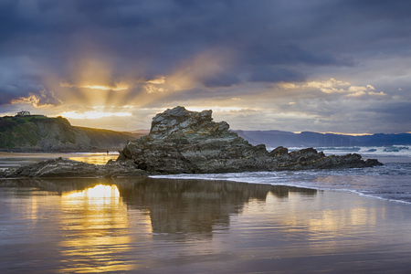 Dusk at the Arrietara beach, in Sopela, Basque Country, Spain. With the rock Pex Txuri dominating the image