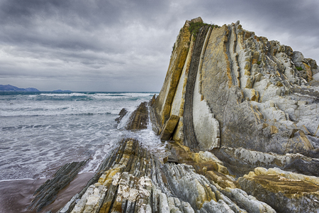 Flysch rock formation in the Barinatxe beach of Sopelana, Basque Country, Spain Zdjęcie Seryjne