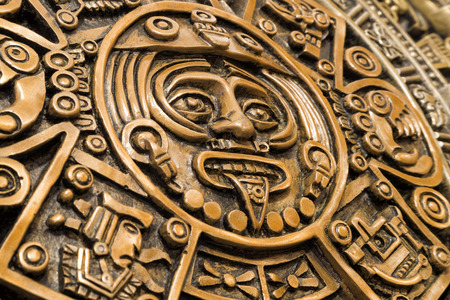 Close view of the Tonatiuh face in the center of the ancient Aztec calendar, also called the Aztec sun stone