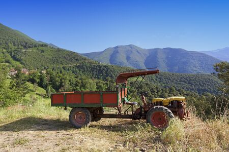 Old two wheeled tractor in the mountains close to a small village