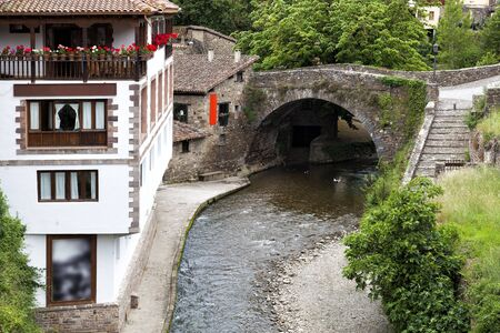 Medieval bridge in the small village of Potes, in Cantabria, Spain
