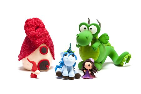 Unicorn, gnome, dragon, young lady and house handmade with modelling clay Standard-Bild