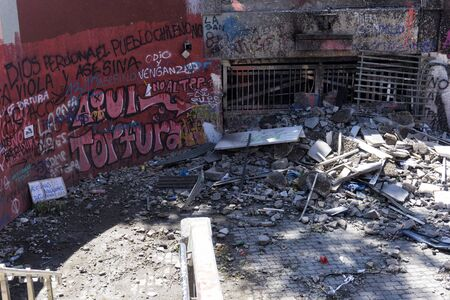 Ruined entrance to Baquedano underground station in Santiago de Chile, after the demonstration