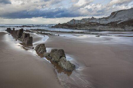 Rocky beach of Sopela, Spain, at dusk