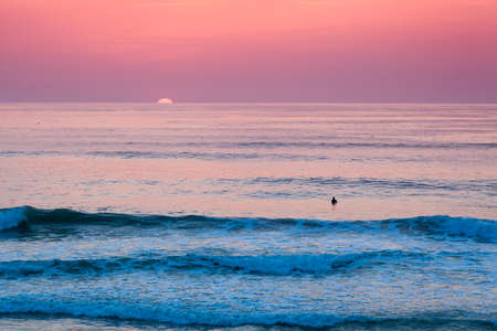 Swimmer in the sea at sunset
