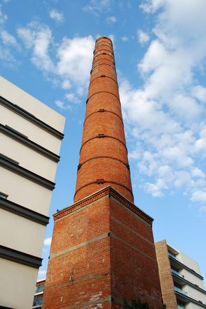 tall chimney: Tall Brick Chimney (Dismantled Industry), Sky Background Stock Photo