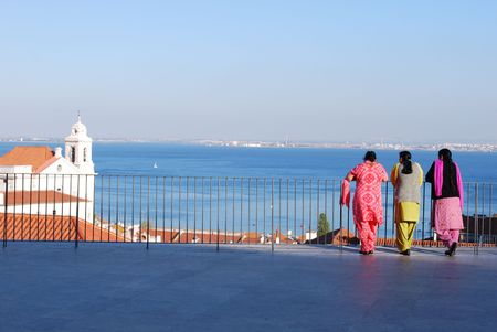 indian women looking at the river Tagus in Lisbon, Portugal photo