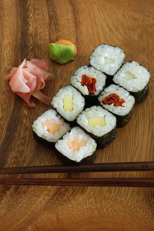 high quality photo of sushi meal (hossomaki salmon) and chopsticks photo