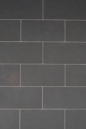 wall made of rectangular grey shale stones photo
