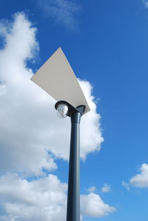 lamp post: modern street lamp with blue sky background