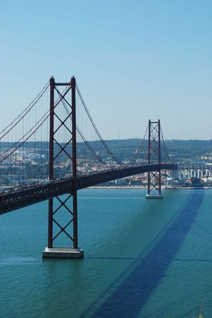 famous bridge Abril 25th and old Salazar Bridge in Lisbon, Portugal photo