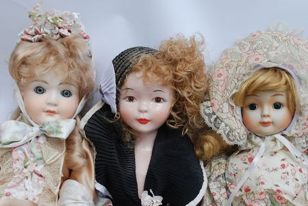 fashion doll: Portrait of a retro porcelain doll family Stock Photo