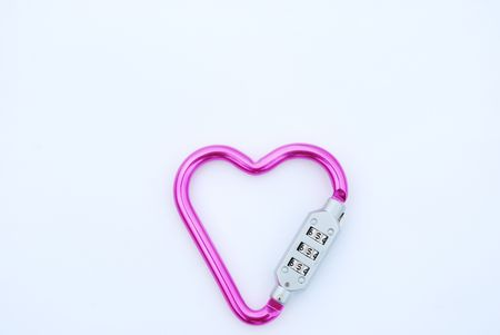 photo of a heart shaped violet carabiner with lockpad photo
