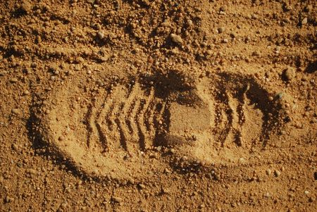 foot marks: boot print of a agriculture men Stock Photo
