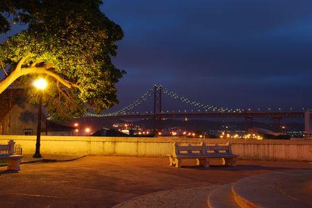 photo of April 25th Bridge, landscape of Lisbon in Portugal (after sunset) photo