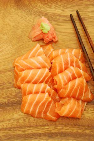 sushi meal with sashimi (salmon) and chopsticks photo