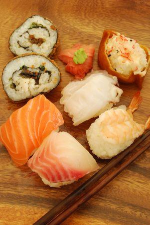 sushi meal with nigiris (salmon, swordfish, shrimp, octupus) and tofusardine rolls photo