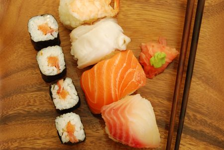 sushi meal with nigirismakis (salmon, swordfish, shrimp, octupus) and chopsticks photo