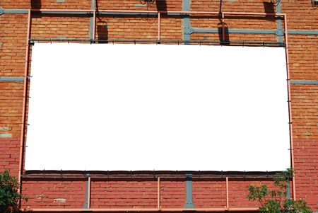 blank billboard announcement on a brick building photo