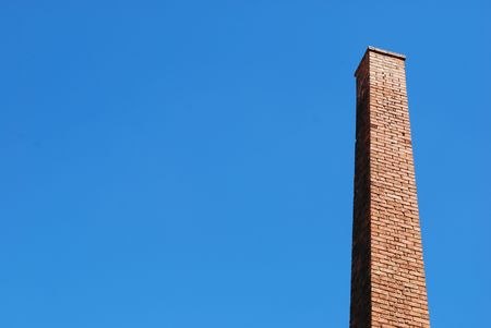 photo of a beautiful brick chimney with sky background photo