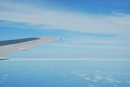 photo of a airplane wing and clouscape scene Stock Photo - 5415622