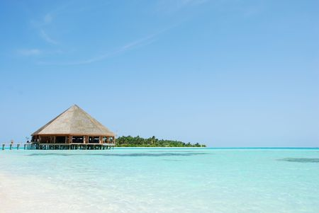 beautiful tropical beach and wooden bungalow in Maldives photo