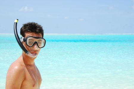 closeup of a young snorkeler man in a tropical island