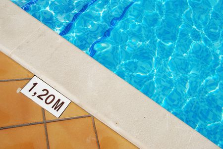close-up of a 1.2m pool depth sign at the swimming pool photo