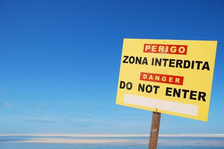 yellow do not enter sign on a dangerous zone at the beach Stock Photo - 5674441
