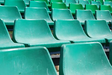 close up of green seats on a beach stadium photo
