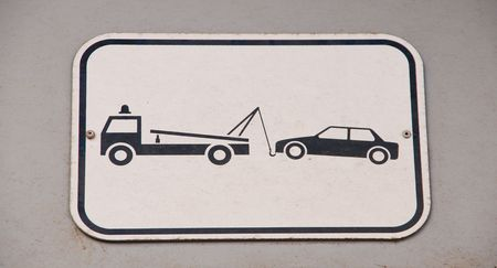 gray and black vehicles towing sign  photo