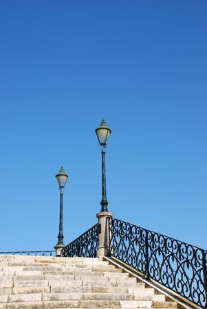 lampost: beautiful close up of a typical stairway made of calcada pavement with a gorgeous retro lamp post