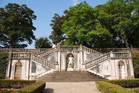 beautiful ornamental Ajuda garden with an antique staircase and statue in Lisbon, Portugal photo
