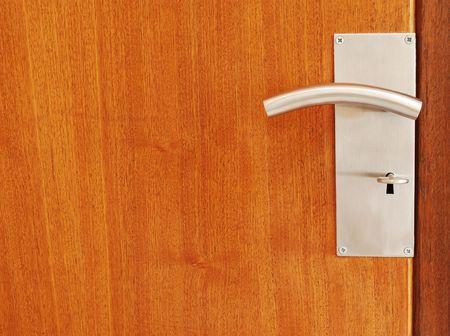 wooden door with metallic door handle with key Stock Photo - 6071125