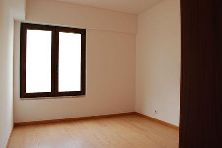 empty room with window and wooden floor photo
