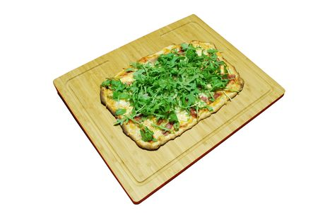 homemade pizza with 3 cheeses with prosciutto and arugula (on wooden board) photo