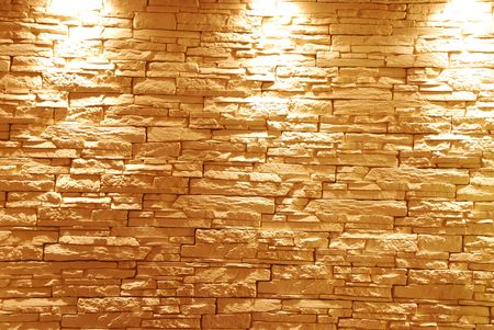 grey and unshaped stone wall with lights photo