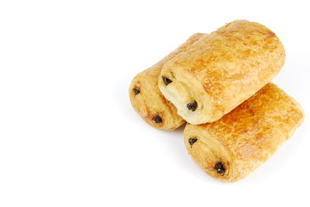 three fresh pain au chocolat isolated on white background photo