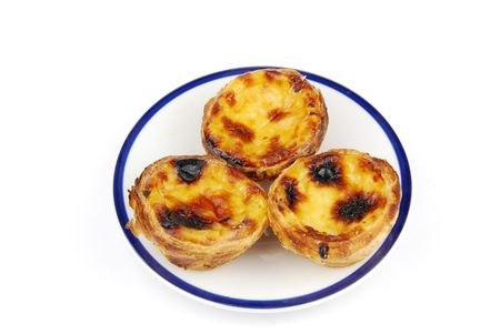 delicious pasteis de nata, typical pasty from Lisbon - Portugal (isolated on white background) photo