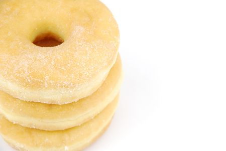 pile of delicious donuts isolated on white background (close up)  photo