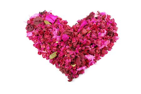 beaufiful pink heart made of dried petals, leaves, flowers (isolated on white background) photo