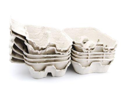 pile of empty egg boxes isolated on white background photo